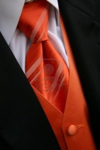 6510557-a-closeup-image-of-an-orange-tie-vest-and-tux